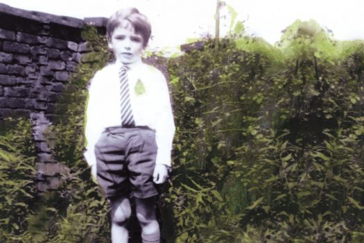 Photo of Mark Dowd as a young boy, as featured on the cover of his new book, Queer and Catholic
