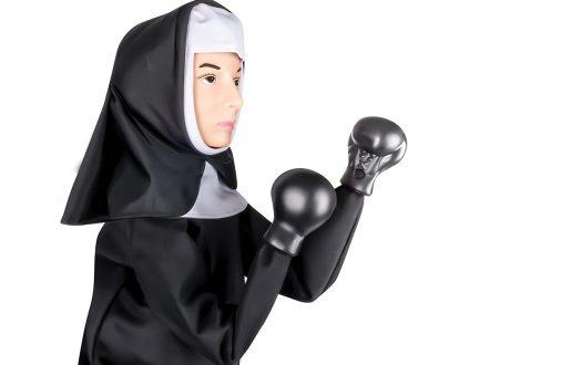 Photo of punching nun glove puppet