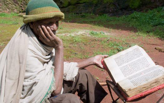 Ethiopian man reading the Bible