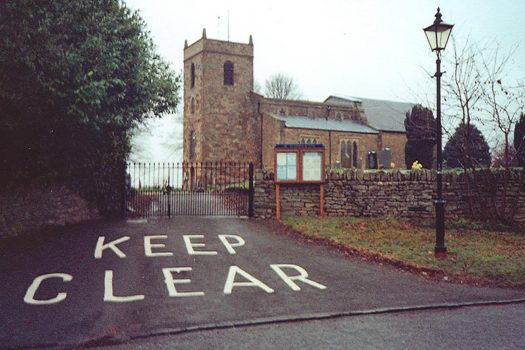 Photo of a church with a big keep clear notice